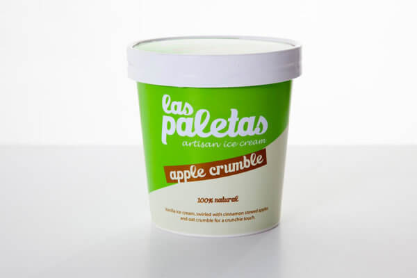 Natural Apple Crumble Ice Cream swirled with cinnamon stewed apples and oat crumble in a tub by Las Paletas
