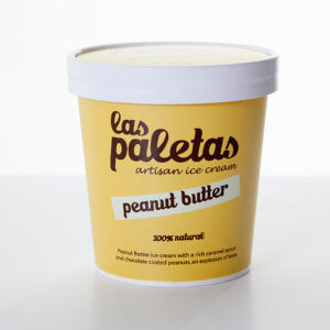 Creamy Peanut Butter Ice Cream swirled with caramel and chocolate coated peanuts in a tub by Las Paletas