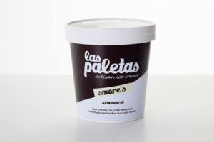 Dark Chocolate Smore's Ice Cream swirled with marshmallow and cookie crumble in a tub by Las Paletas