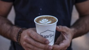 Man holding Blackbox Coffee